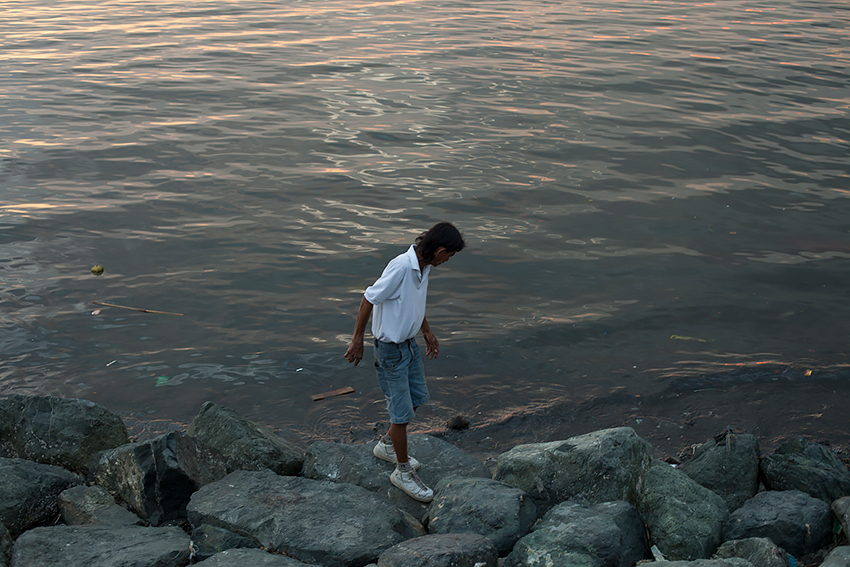 Jason Reblando - Man on Rocks, Manila Bay
