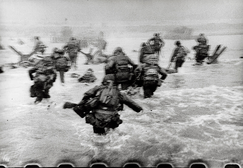 Robert Capa - American soldiers landing on Omaha Beach, D-Day, Normandy, France. June 6, 1944.
