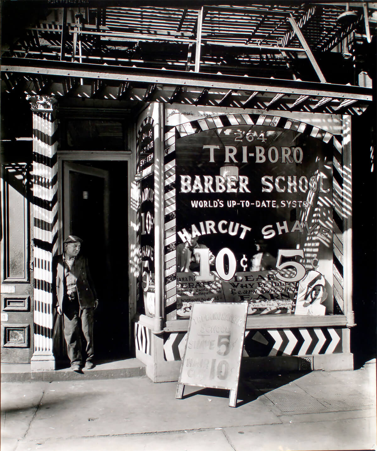Tri-boro Barber School, 264 Bowery, Manhattan, photograph by Berenice Abbott, 1935. ©New York Public Library<p>© Berenice Abbott</p>