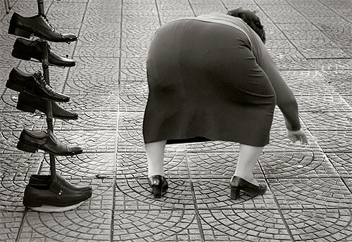 Woman, shoes and coin, Tirana, Albania 2012<p>© Kristoffer Albrecht</p>