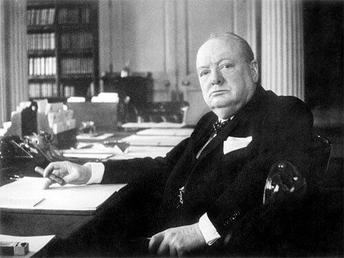 Cecil Beaton - Winston Churchill at his seat in the Cabinet Room at No 10 Downing Street, London. © IWM Non Commercial Licence