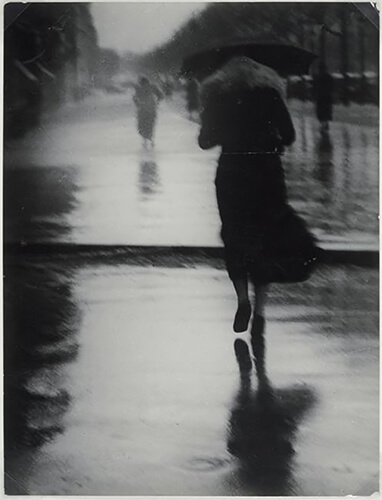 George Brassaï - Passerby in the Rain, 1935