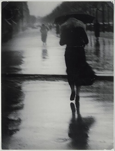George Brassaï - Passerby in the Rain (1935)