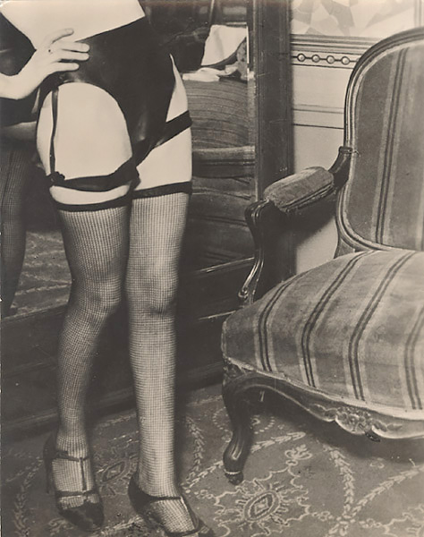 George Brassaï - Female Model in Net Stocking and Leather Panties, 1932