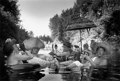 Seattle, Washington. 1953. Members of the Seattle Tubing Society in full float.<p>Courtesy Magnum Photos / © Burt Glinn</p>