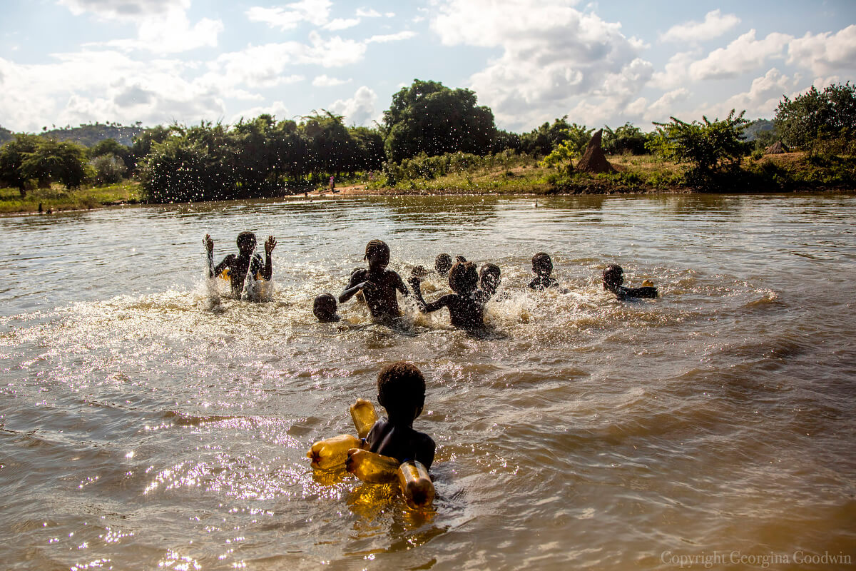 Children play in a dam in Collum Coal Mine in Zambia's southern Province, May 3, 2018<p>© Georgina Goodwin</p>
