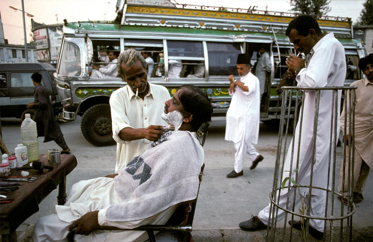 Pakistan Encountered. Mohamed Sadiq, 60, a barber for 40 years, runs business in Fawara Chauk (Fountain Square) in city of Rawalpindi, 1998.<p>Courtesy VII Photo Agency / © Ed Kashi</p>