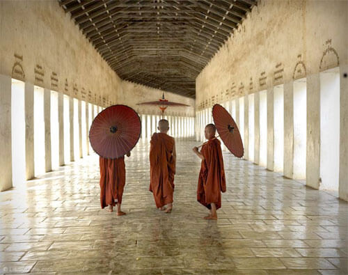 Lisa Kristine - Three Parasols, Myanmar