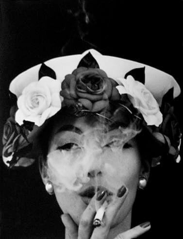 Hat and Five Roses, Paris, 1956<p>Courtesy Trunk Archive / © William Klein</p>