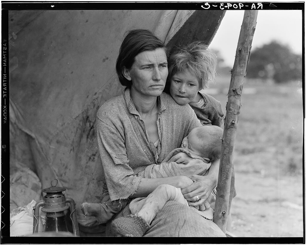 Dorothea Lange - Resettled at Bosque Farms project. Family of four from Taos Junction shows temporary dwelling 1936 © Library of Congress