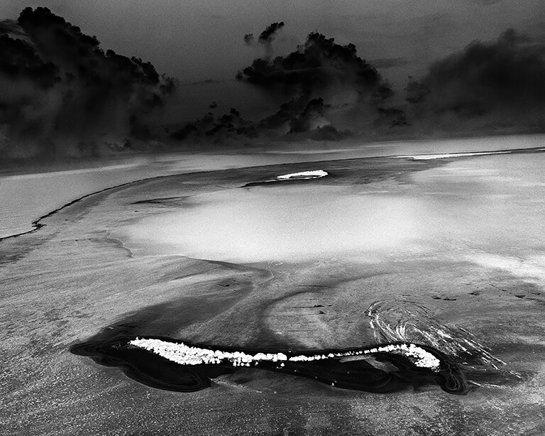 Mile Wide, 200 Foot Deep 1952 MIKE Crater, 10.4 Megatons, Enewetak Atoll, 2003<p>© Michael Light</p>