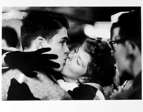 Jay Maisel - Couple kissing, man looking away, New Year