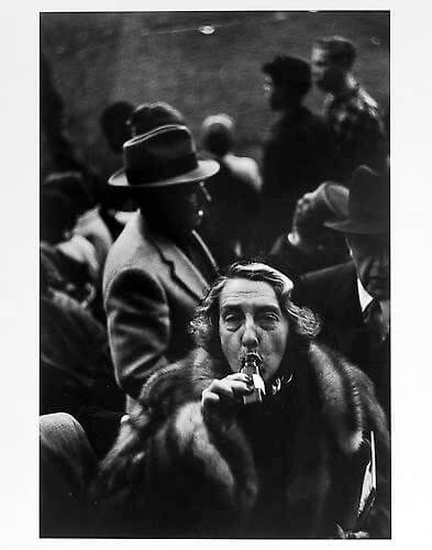 Jay Maisel - Woman drinking from bottle after game, Ebbetts Field, Brooklyn mid 1950s