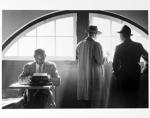 Jay Maisel - Sprits writers, one at typewriter mid 1950s