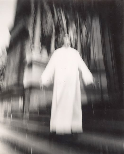 A Priest at St. John the Divine Seems to Be Flying, New York, NY, 1974<p>© Arthur Tress</p>