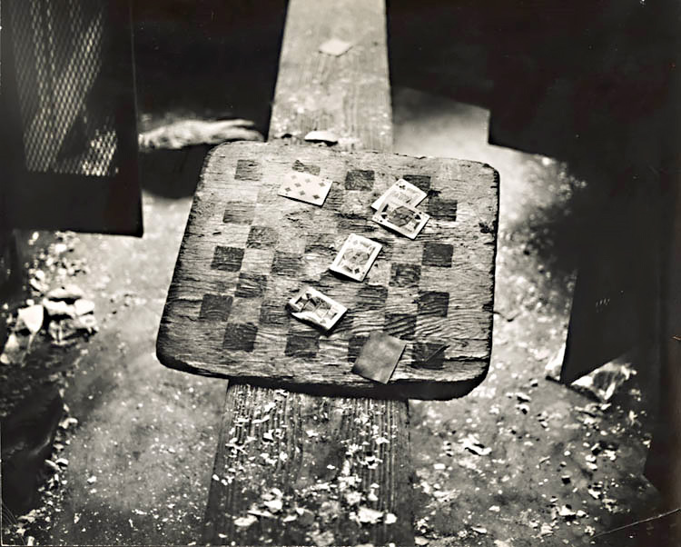 Cards and Checkerboard in Abandoned Locker Room for Railroad Workers 1970c<p>© Arthur Tress</p>