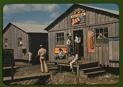 "Marion Post Wolcott - Living quarters and a ""juke joint"" for migratory workers during a slack season, in Belle Glade, Florida, taken in early 1941. ©Library of Congress"